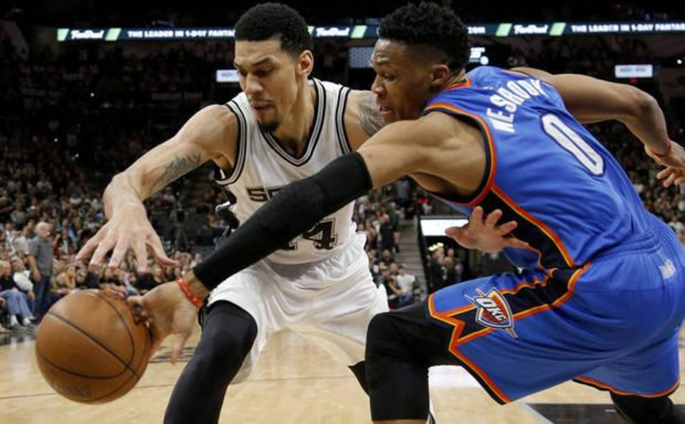 Photo - Russell Westbrook tries to steal the ball from Danny Green in Game 2. (Photo by Bryan Terry)