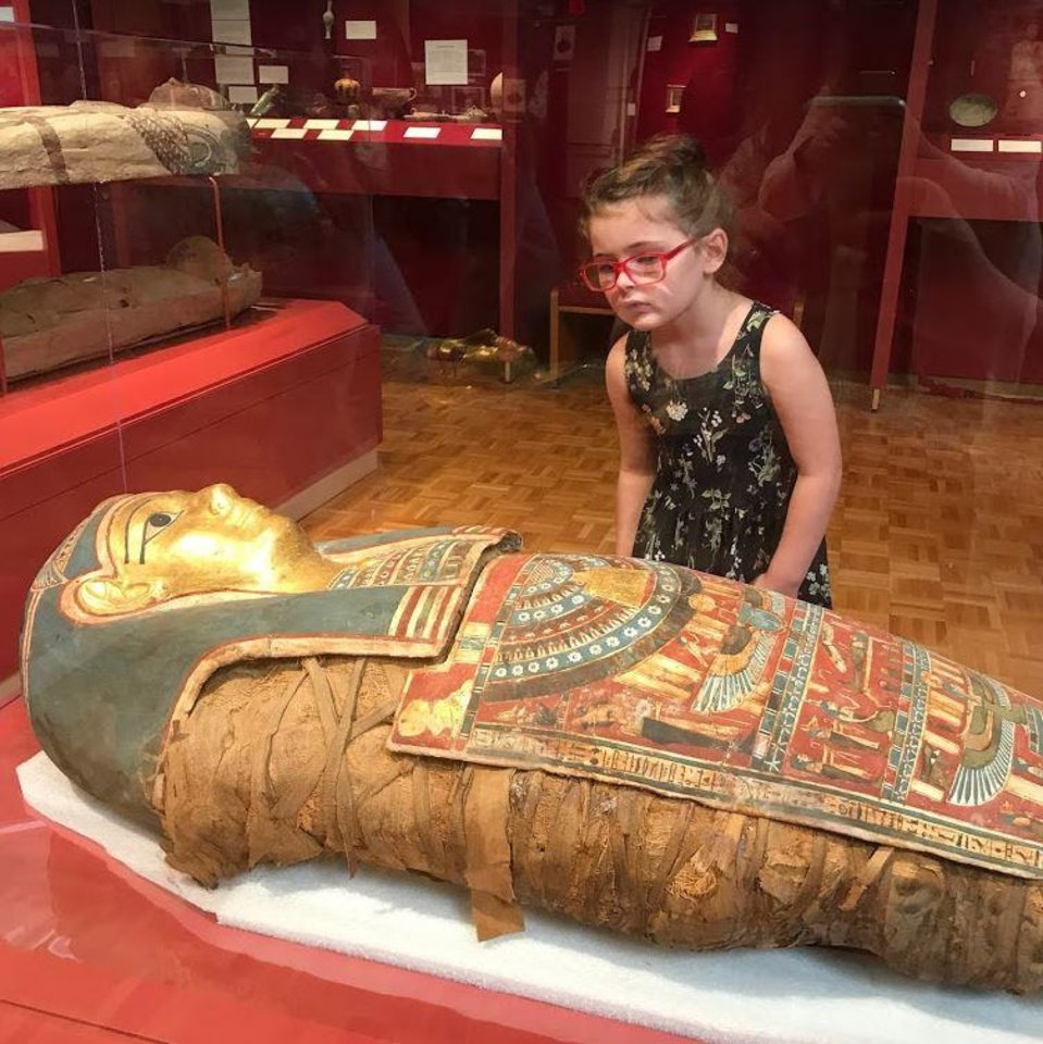 Photo - A girl looks at the mummy known as Tutu at the Mabee-Gerrer Museum of Art in Shawnee. [Photo provided]