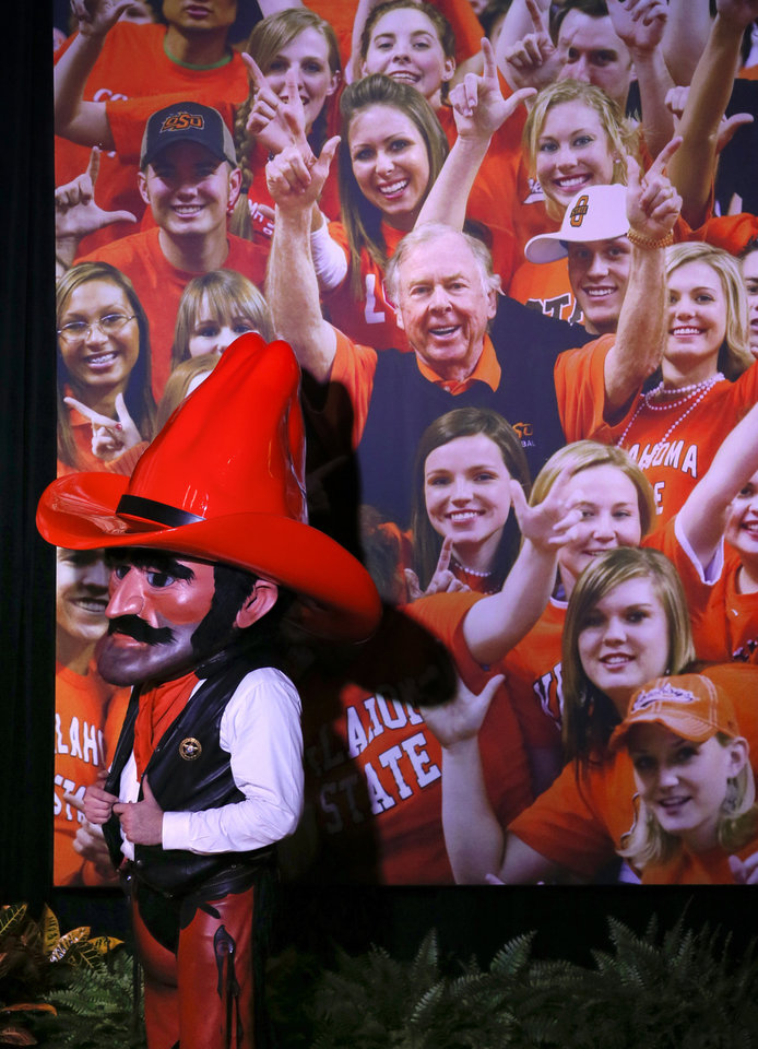 Photo - Oklahoma State mascot Pistol Pete stands next to a photo of OSU alumnus and benefactor Boone Pickens with fans during the Celebration of Life for Pickens at Gallagher-Iba Arena in Stillwater, Okla., Wednesday, Sept. 25, 2019. [Nate Billings/The Oklahoman]