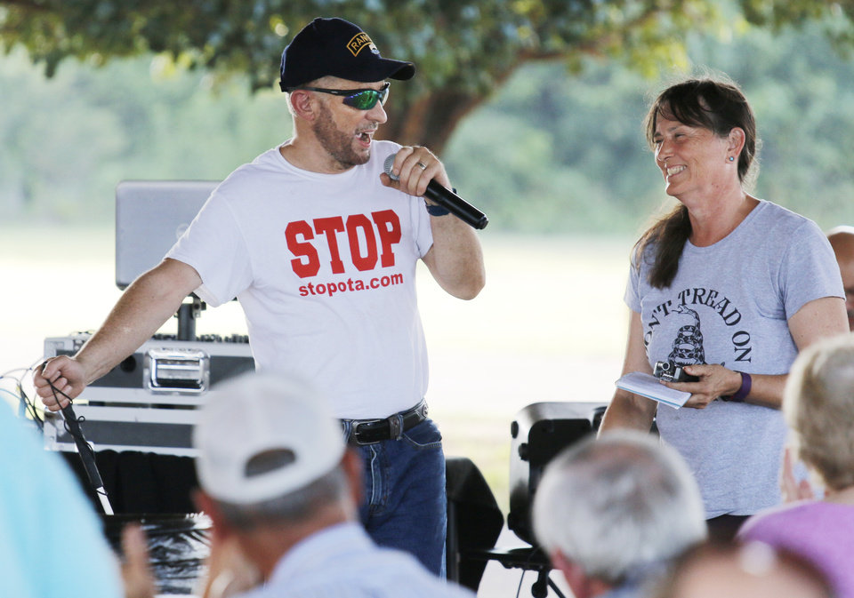 Photo - Steve Maguire and his wife Susan Maguire, before he speaks during the Victimsofiminentdomain.com rally at Choctaw Creek Park, in Choctaw, against the eastern Oklahoma county turnpike leg that the Oklahoma Turnpike Authority has proposed building Friday, August 12, 2016. Photo by Doug Hoke, The Oklahoman