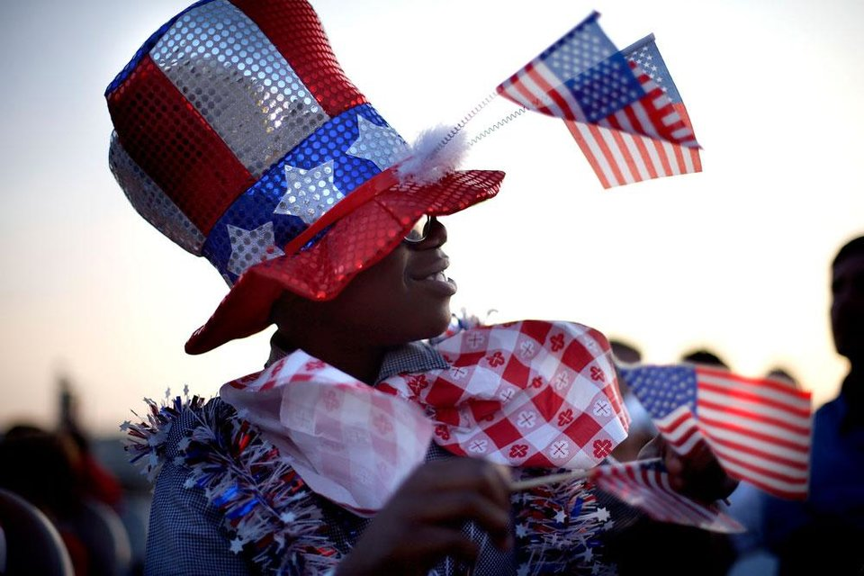 Photo -  Campbell Walker Fields, 11, waves flags during the Red, White and Boom at the State Fair Park in Oklahoma City, Tuesday, July 3, 2012. Photo by Sarah Phipps, The Oklahoman
