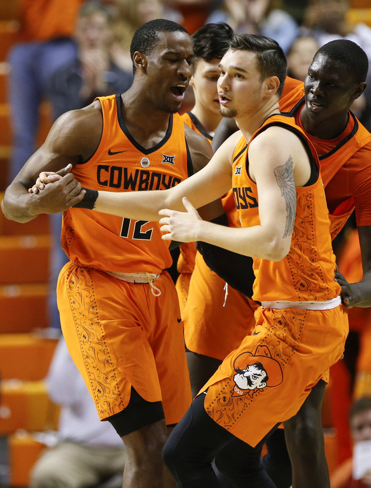 Photo -  Oklahoma State captains Cam McGriff (12), Thomas Dziagwa (4) and Lindy Waters, background, signed with a coach they never played for, had a teammate die and lost an assistant coach amid an FBI investigation. [NATE BILLINGS/THE OKLAHOMAN]