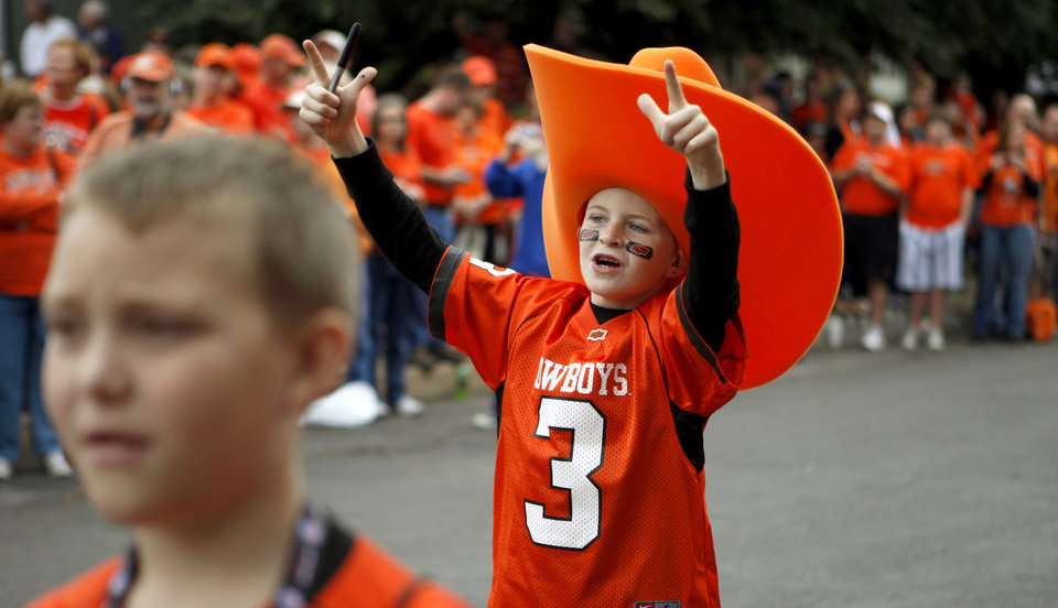 Photo - Gage Milner, 7, of Duke, Okla., cheers during the Spirit Walk before the college football game between the Oklahoma State Cowboys (OSU) and the Nebraska Huskers (NU) at Boone Pickens Stadium in Stillwater, Okla., Saturday, Oct. 23, 2010. Photo by Bryan Terry, The Oklahoman