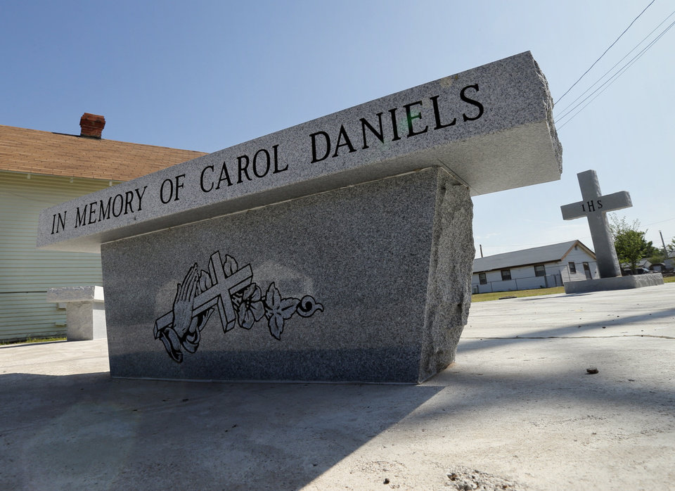 Photo - UNSOLVED MURDER: The church has been destroyed, but a memorial has replaced the site where Pastor Carol Daniels was murdered in 2009 on Wednesday, May 8, 2013 in Anadarko, Okla.  Photo by Steve Sisney, The Oklahoman