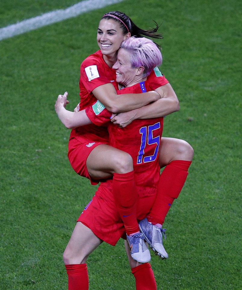 Photo -  United States' Megan Rapinoe, right, congratulates teammate Alex Morgan after scoring her fifth goal during the Women's World Cup Group F soccer match between the United States and Thailand at the Stade Auguste-Delaune in Reims, France, Tuesday, June 11, 2019. (AP Photo/Francois Mori)