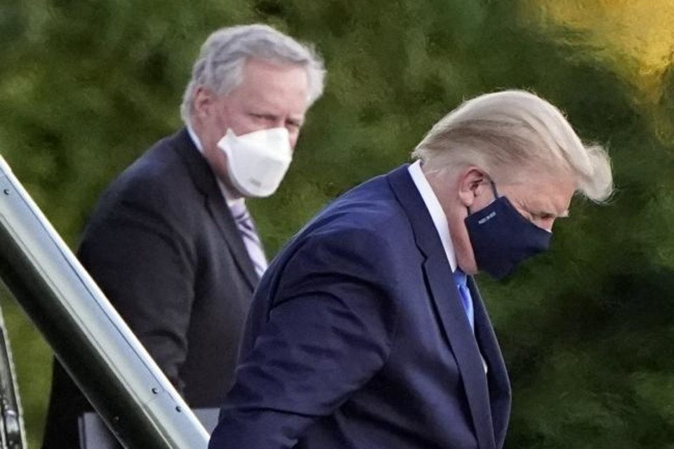 Photo -  President Donald Trump arrives Friday at Walter Reed National Military Medical Center, in Bethesda, Md., on Marine One after he tested positive for COVID-19. [AP PHOTO]