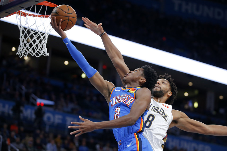 Photo - Oklahoma City's Shai Gilgeous-Alexander (2) goes past New Orleans' Jahlil Okafor (8) during an NBA basketball game between the Oklahoma City Thunder and the New Orleans Pelicans at Chesapeake Energy Arena in Oklahoma City, Saturday, Nov. 2, 2019.  [Bryan Terry/The Oklahoman]