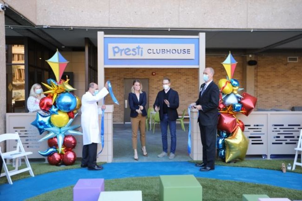 Photo -  Sam Presti and his wife, Shannon, take part in the ribbon cutting ceremony for the Presti Clubhouse on Monday at Oklahoma Children's Hospital. [Photo provided by Oklahoma Children's Hospital]