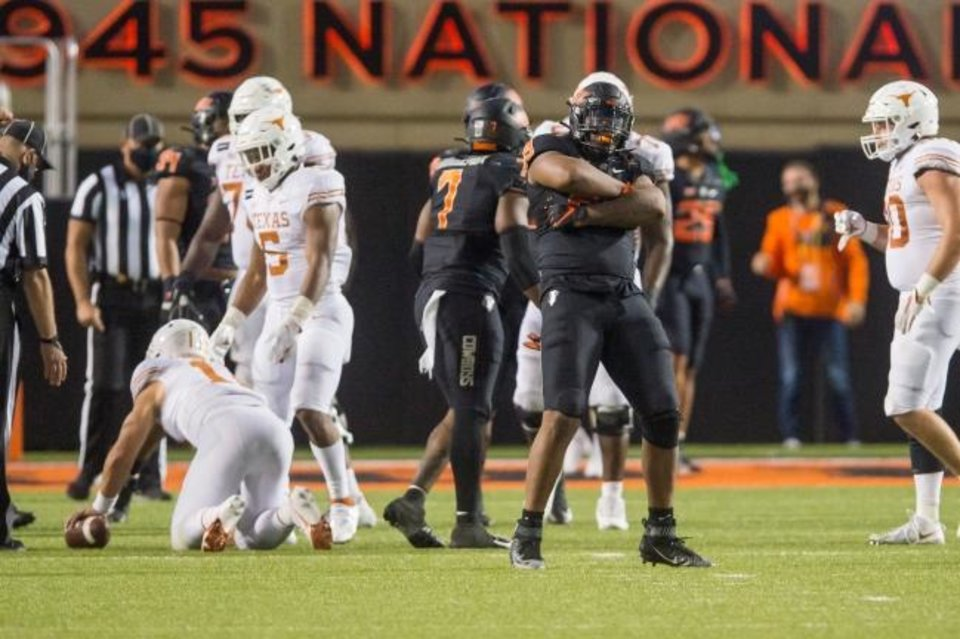 Photo -  OSU defensive end Tyler Lacy (89) celebrates after sacking Texas quarterback Sam Ehlinger (11) during an overtime loss on Oct. 31. [Brett Rojo/USA TODAY Sports]