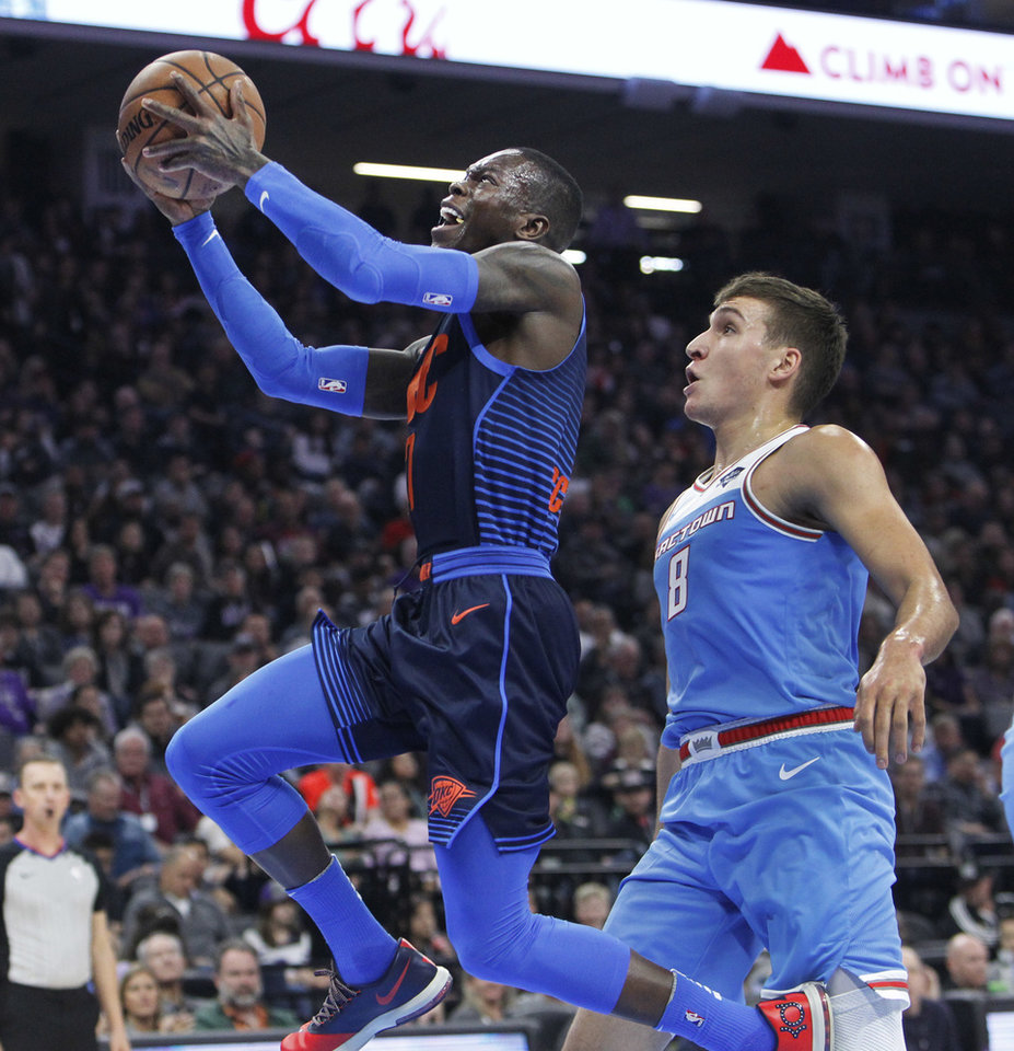Oklahoma City Thunder guard Dennis Schroder drives to the basket around Sacramento  Kings guard Bogdan Bogdanovic during Mondays game in Sacramento, Calif.