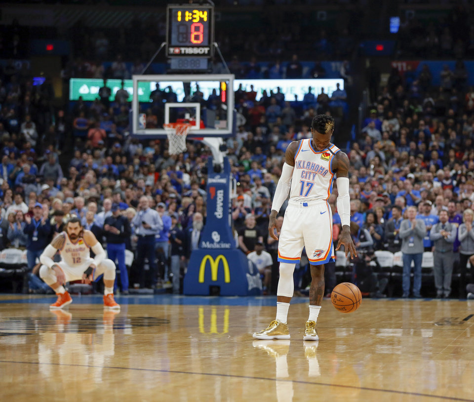 Photo - Oklahoma City's Dennis Schroder (17) dribbles the ball before taking a 24 second violation to honor NBA legend Kobe Bryant of the Los Angeles Lakers on the second possession of an NBA basketball game between the Oklahoma City Thunder and Dallas Mavericks at Chesapeake Energy Arena in Oklahoma City, Monday, Jan. 27, 2020. Dallas took an eight second violation on the first possession. Bryant, who wore eight and later 24 in his career, died with eight others in a helicopter crash on Sunday. [Nate Billings/The Oklahoman]
