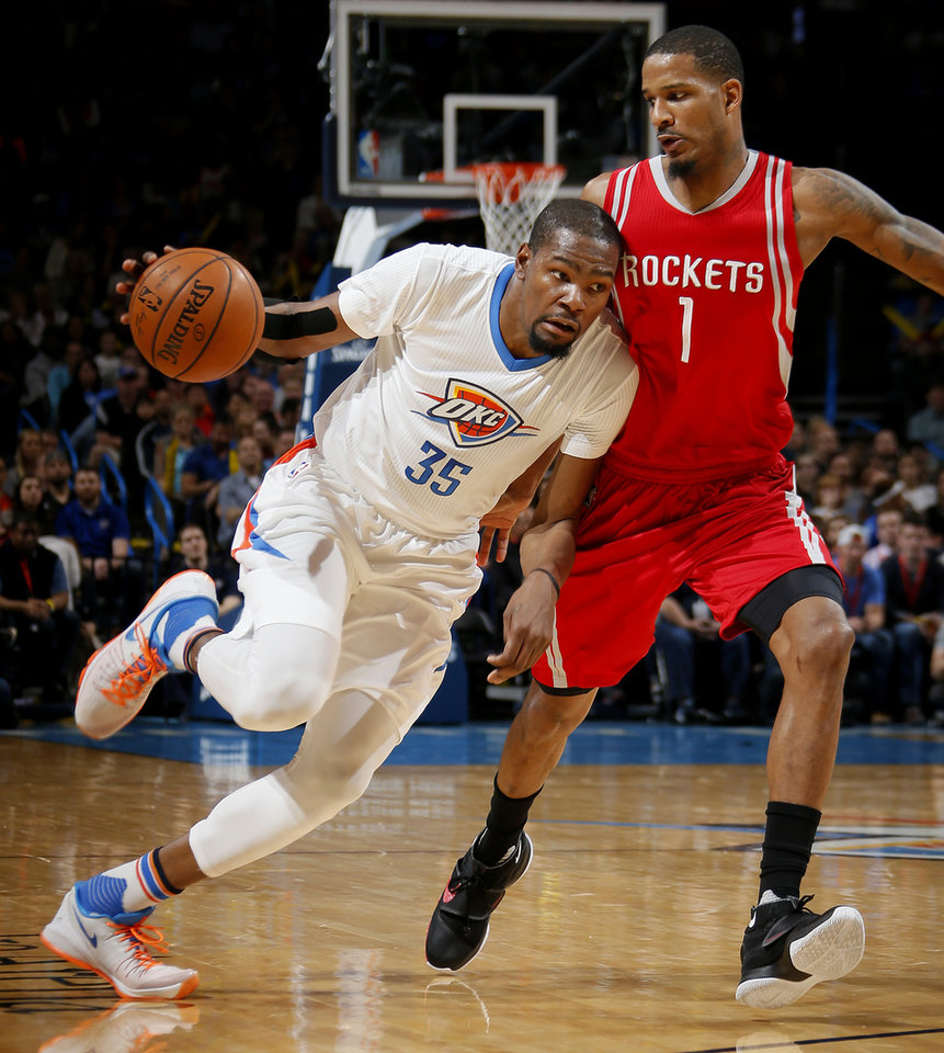 Photo - Oklahoma City's Kevin Durant (35) goes past Houston's Trevor Ariza (1) during an NBA basketball game between the Oklahoma City Thunder and the Houston Rockets at Chesapeake Energy Arena in Oklahoma City, Tuesday, March 22, 2016. Photo by Bryan Terry, The Oklahoman