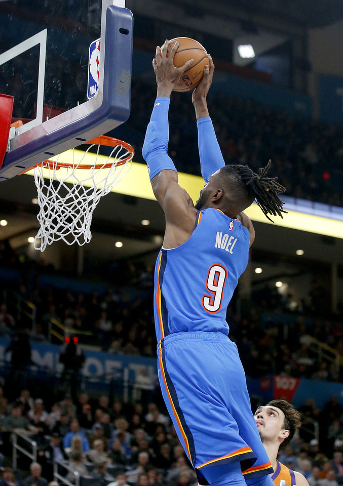 Photo - Oklahoma City's Nerlens Noel (9) goes up for a dunk during the NBA basketball game between the Oklahoma City Thunder and the Utah Jazz at the Chesapeake Energy Arena in Oklahoma City , Friday, Dec. 20, 2019.   [Sarah Phipps/The Oklahoman]