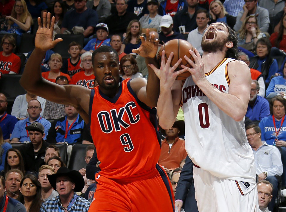 Photo - Oklahoma City's Serge Ibaka (9) fouls Cleveland's Kevin Love (0) during an NBA basketball game between the Oklahoma City Thunder and the Cleveland Cavaliers at Chesapeake Energy Arena in Oklahoma City, Sunday, Feb. 21, 2016. Oklahoma City lost 115-92.  Photo by Bryan Terry, The Oklahoman