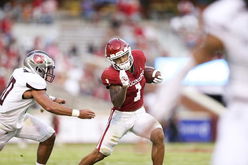Photo - OU running back Seth McGowan runs the ball during Saturday's game against Missouri State. [IAN MAULE/Tulsa World]