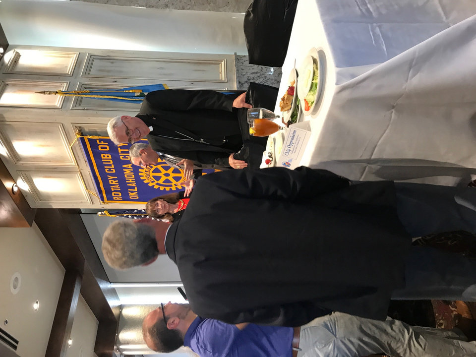 Photo - The Most Rev. Paul S. Coakley, archbishop of the Archdiocese of Oklahoma City, at right, talks with a guest at the Rotary Club of Oklahoma City's luncheon on Tuesday, Sept. 5, at the Petroleum Club in downtown Oklahoma City. [Photo by Carla Hinton, The Oklahoman]