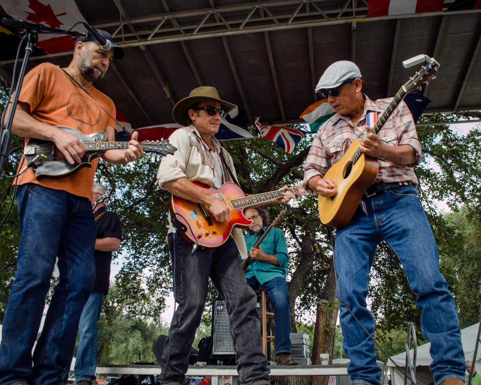 Photo -  John Cooper, left, performing alongside the Red Dirt Rangers. The longtime Oklahoma-based singer-songwriter helps curate Bob Childers Gypsy Cafe songwriter festival. [Photo provided by Tom Dunning]
