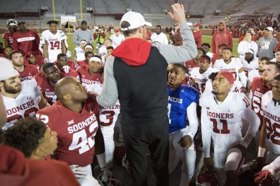 Photo -  OU coach Lincoln Riley talks with his team after last April's spring football game at Owen Field in Norman. [Bryan Terry/The Oklahoman]