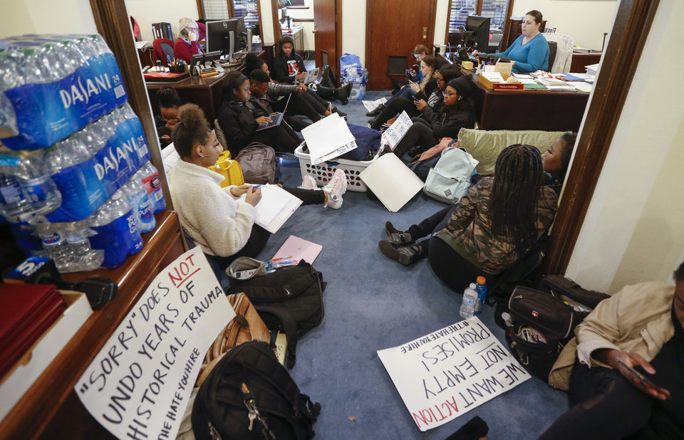 Photo - OU students participate in a sit-in organized by the Black Emergency Response Team student group outside of the office of OU provost Kyle Harper in Evans Hall at the University of Oklahoma in Norman, Okla., Wednesday, Feb. 26, 2020. The protest comes after two incidents where faculty members used a racial slur while teaching. [Nate Billings/The Oklahoman]