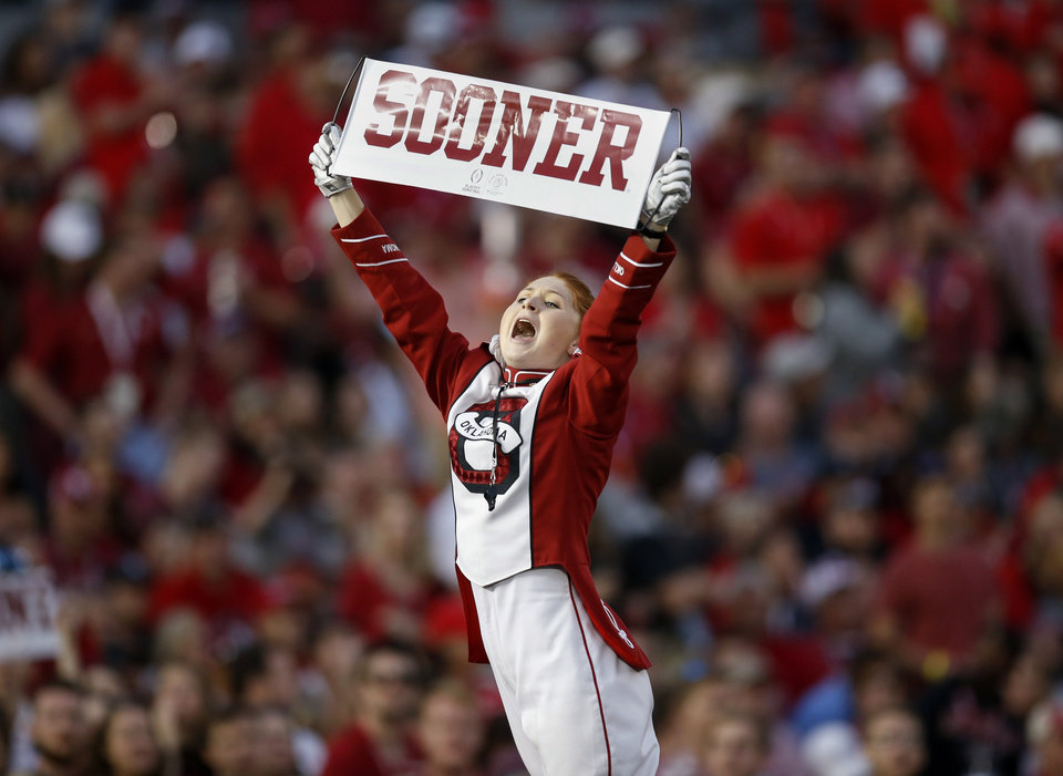 "Photo - Pride of Oklahoma drum major Julie Siberts leads a chant of ""Boomer Sooner"" during the Rose Bowl Game, a College Football Playoff Semifinal, between the Oklahoma Sooners (OU) and Georgia Bulldogs (UGA) at the Rose Bowl in Pasadena, California, Monday, Jan. 1, 2018. Georgia won 54-48 in double overtime. Photo by Nate Billings, The Oklahoman"