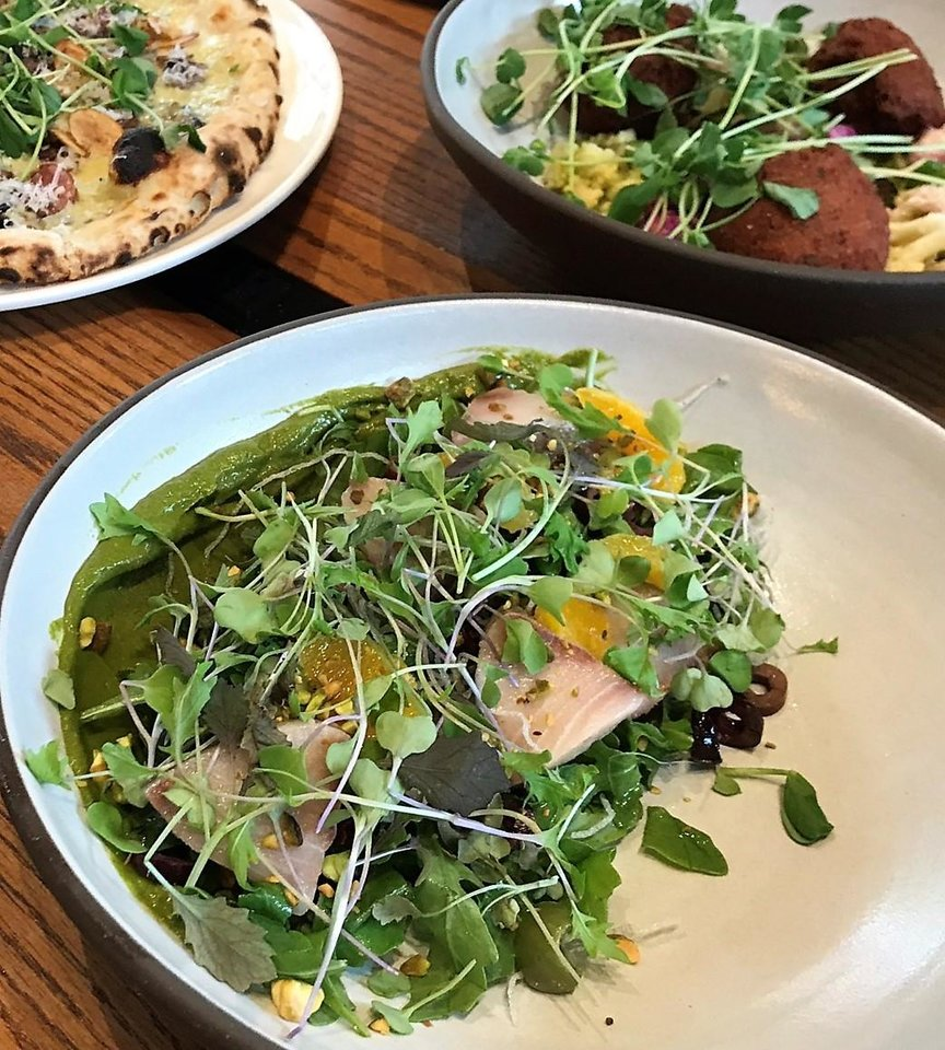 Photo -  Hamachi crudo, center, falafel, right, and truffled mushroom pizza from The Jones Assembly in downtown Oklahoma City. [Dave Cathey/The Oklahoman]