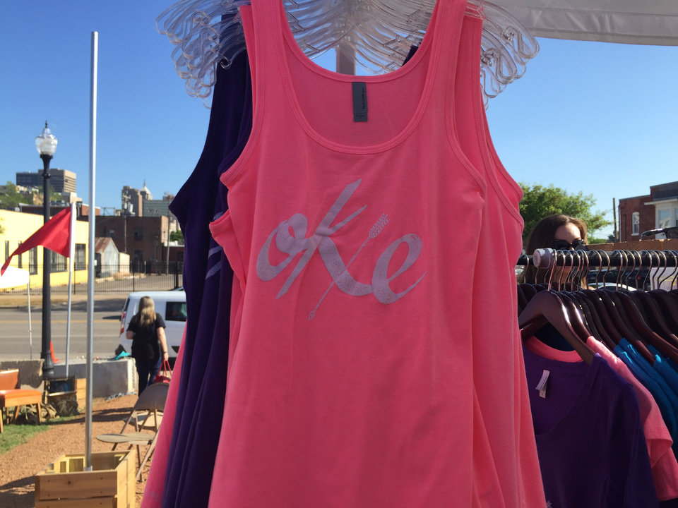 "Photo -  An ""Okie"" tank top is for sale at The Okay See booth at Industry Flea in Oklahoma City. Photo by Heather Warlick, The Oklahoman"
