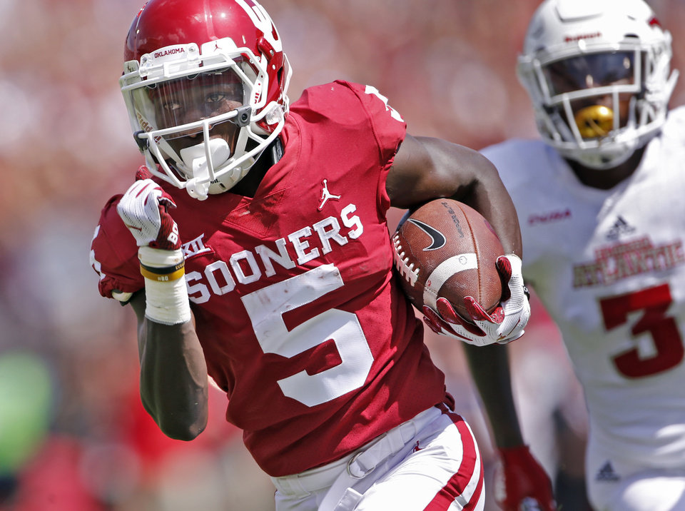Photo - Oklahoma's Marquise Brown (5) catches a Kyler Murray pass for a touchdown during a college football game between the University of Oklahoma Sooners (OU) and the Florida Atlantic Owls (FAU) at Gaylord Family-Oklahoma Memorial Stadium in Norman, Okla., on Saturday, Sept. 1, 2018. Photo by Steve Sisney, The Oklahoman