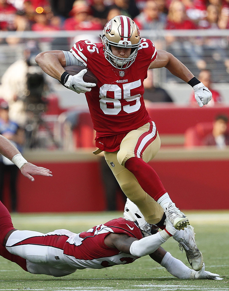Photo -  San Francisco tight end George Kittle tries to break a tackle against Arizona on Oct. 7. [AP PHOTO]