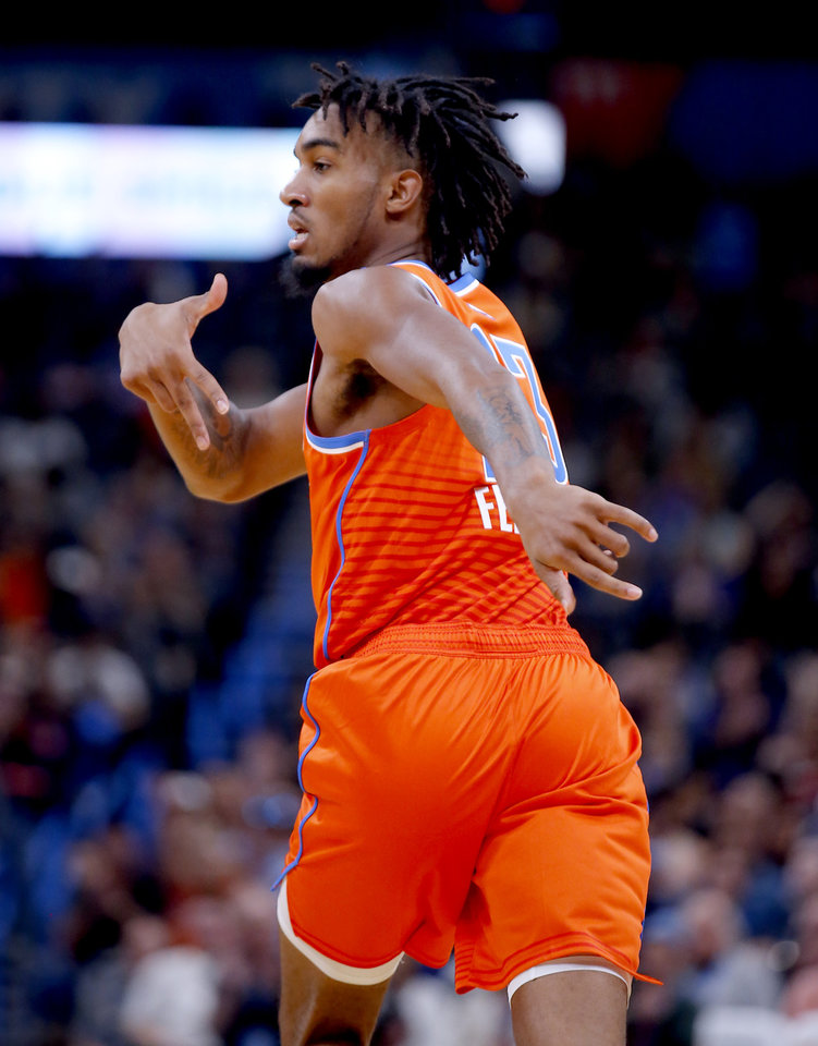 Photo - Oklahoma City's Terrance Ferguson (23) celebrates a basket during the NBA game between the Oklahoma City Thunder and Golden State Warriors at Chesapeake Energy Arena,  Sunday, Oct. 27, 2019. [Sarah Phipps/The Oklahoman]