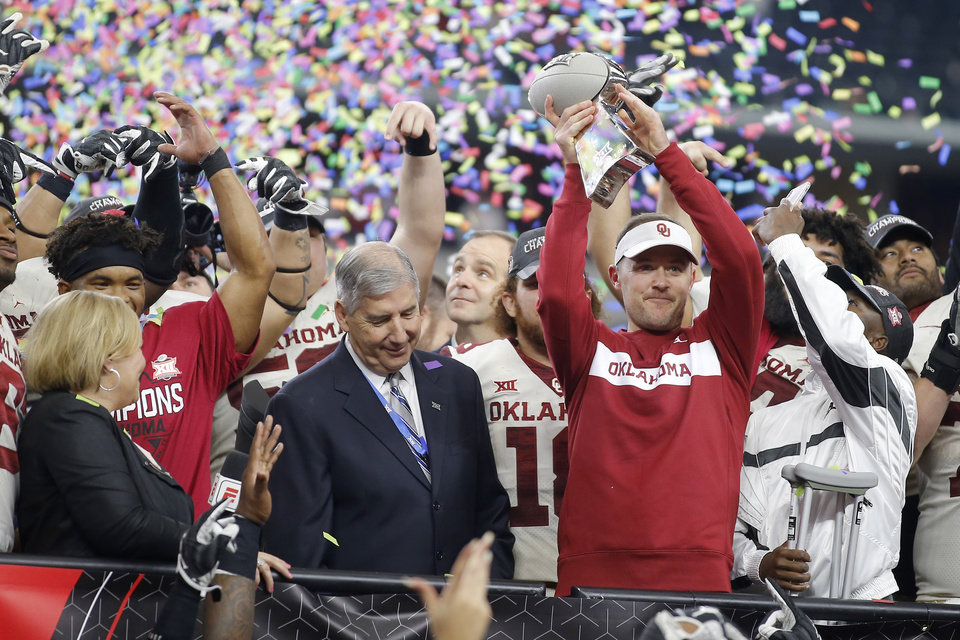 Photo - Oklahoma coach Lincoln Riley holds up the trophy after the Big 12 Championship football game between the Oklahoma Sooners (OU) and the Texas Longhorns (UT) at AT&T Stadium in Arlington, Texas, Saturday, Dec. 1, 2018.  Oklahoma won 39-27. Photo by Bryan Terry, The Oklahoman