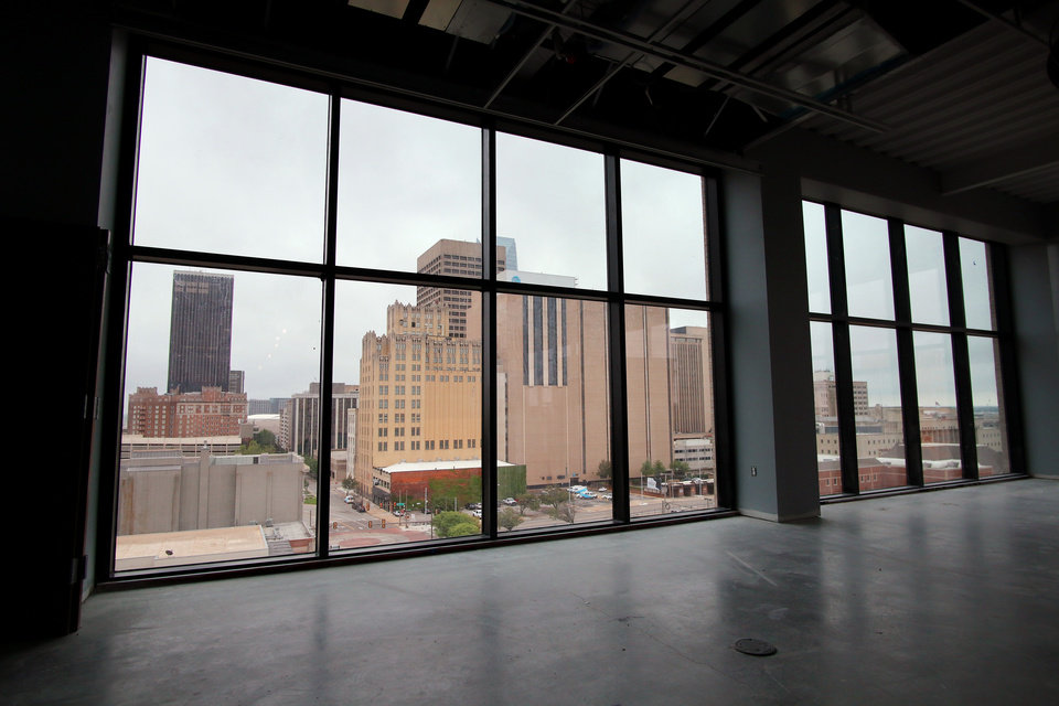 Photo - 7th floor windows looking at skyline. Heartland building progress in downtown at 5th and Broadway, Wednesday, May 13, 2020. [Doug Hoke/The Oklahoman]