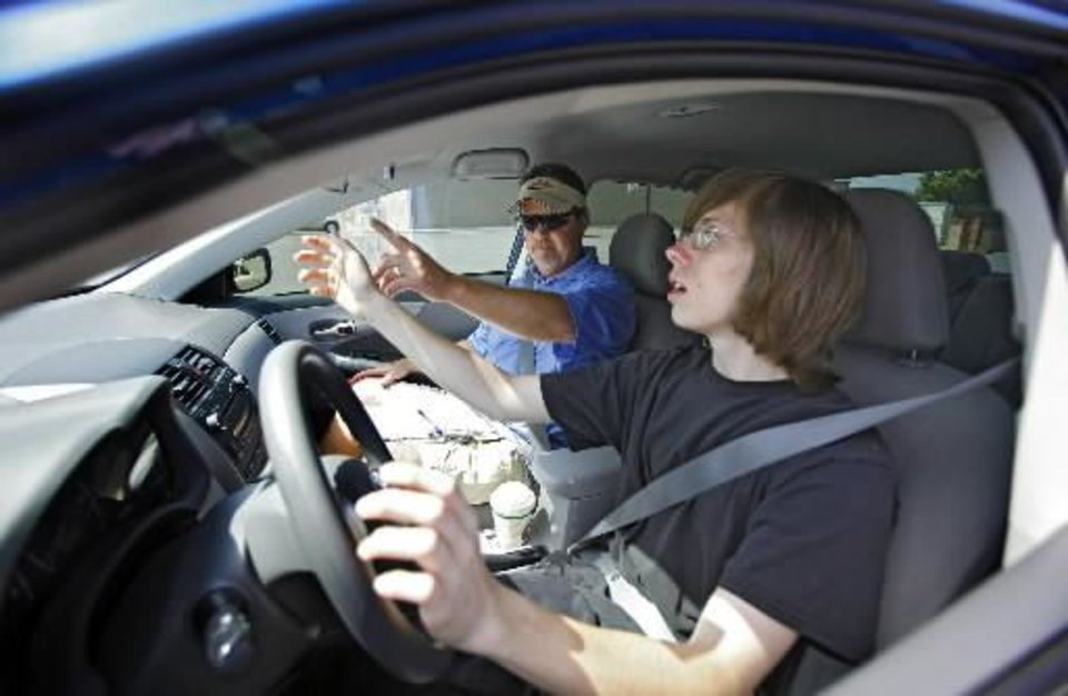 Photo - Driving instructor  Tony  Borum works with driving student Brandon Glad while going though a pre-driving checklist at Brown's Driving School on Thursday, June 3, 2010, in Oklahoma City, Okla. Photo by Chris Landsberger, The Oklahoman