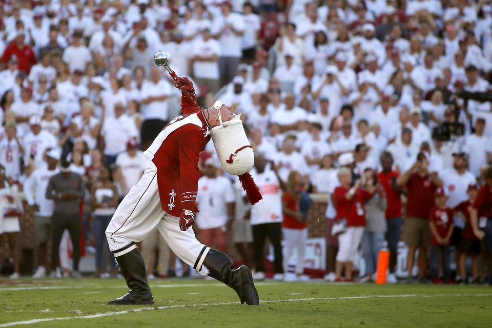 Photo - Drum major Paxton Leaf leads the Pride of Oklahoma before a college football game between the University of Oklahoma Sooners (OU) and the Houston Cougars at Gaylord Family-Oklahoma Memorial Stadium in Norman, Okla., Sunday, Sept. 1, 2019. Oklahoma won 49-31. [Bryan Terry/The Oklahoman]