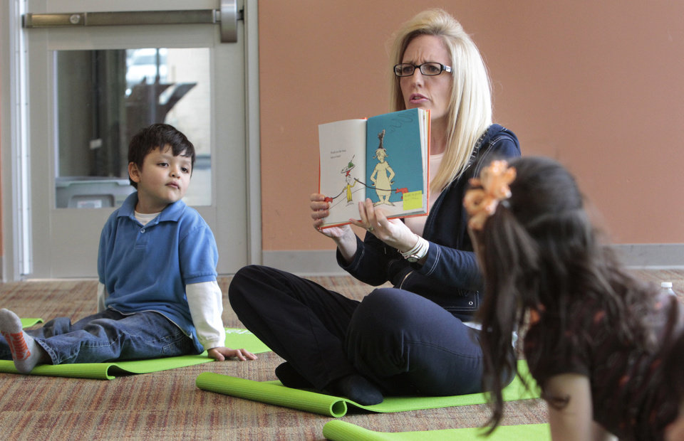 Photo - Angela Moorad uses a Dr. Seuss characters to illustrate poses as she teaches yoga to three and four-year-olds on Wednesday, March 7, 2012, in Oklahoma City Okla.  Photo by Steve Sisney, The Oklahoman