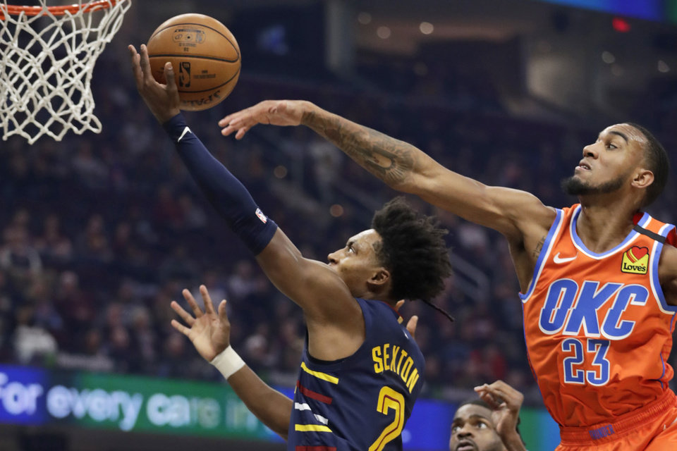Photo - Cleveland Cavaliers' Collin Sexton (2) drives to the basket against Oklahoma City Thunder's Terrance Ferguson (23) in the first half of an NBA basketball game, Saturday, Jan. 4, 2020, in Cleveland. [AP Photo/Tony Dejak]