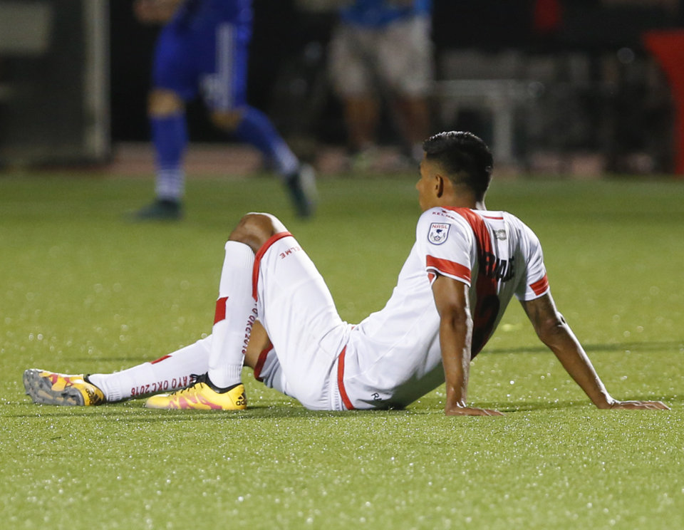 Photo - Rayo OKC's Moises Hernandez (3) sits on the ground at the end of a North American Soccer League game between Rayo OKC and FC Edmonton in Yukon, Okla., Saturday, July 2, 2016. The game ended in a 1-1 tie. Photo by Kurt Steiss, The Oklahoman