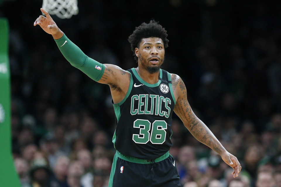 Photo - Boston Celtics' Marcus Smart plays against the Oklahoma City Thunder during the first half of an NBA basketball game, Sunday, March, 8, 2020, in Boston. (AP Photo/Michael Dwyer)