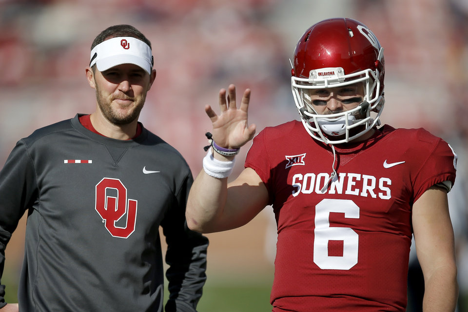 Photo - Oklahoma's Baker Mayfield (6) and coach Lincoln Riley talk before a college football game between the Oklahoma Sooners (OU) and the West Virginia Mountaineers at Gaylord Family-Oklahoma Memorial Stadium in Norman, Okla, Saturday, Nov. 25, 2017. Photo by Bryan Terry, The Oklahoman