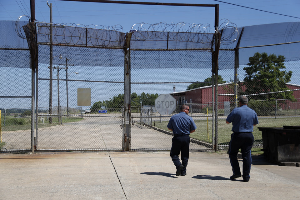 Photo -  Guards prepare to open a gate at the Eddie Warrior Correctional Center in Taft, Thursday, Aug. 4, 2016. [Sarah Phipps/The Oklahoman, file]