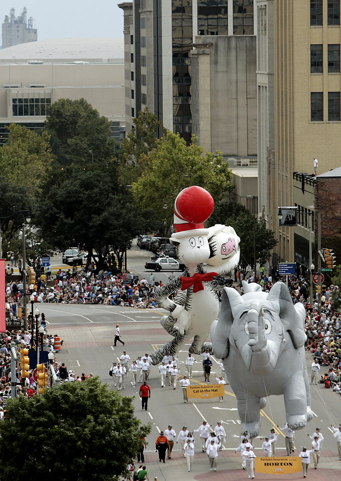 Photo - Horton and the Cat in the Hat baloons make their way down Broadway during the Oklahoma Centennial Parade in Oklahoma City on Sunday, Oct. 14, 2007. By John Clanton, The Oklahoman