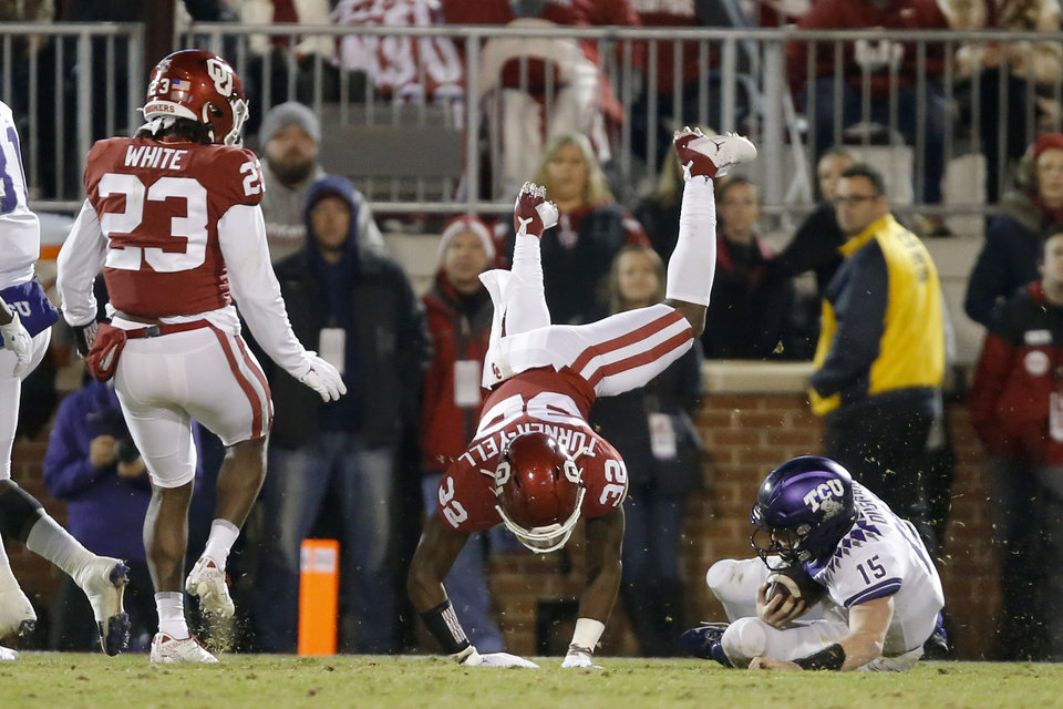 Photo - TCU's Max Duggan (15) slides down beside Oklahoma's Delarrin Turner-Yell (32) during an NCAA football game between the University of Oklahoma Sooners (OU) and the TCU Horned Frogs at Gaylord Family-Oklahoma Memorial Stadium in Norman, Okla., Saturday, Nov. 23, 2019. [Bryan Terry/The Oklahoman]