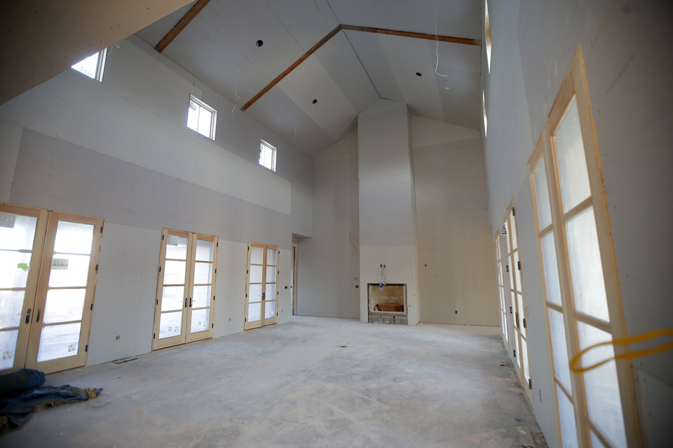 Photo -  This is the living room of Patrick and Amy Finney's home under construction at The Prairie at Post addition. [PHOTO BY BRYAN TERRY, THE OKLAHOMAN]