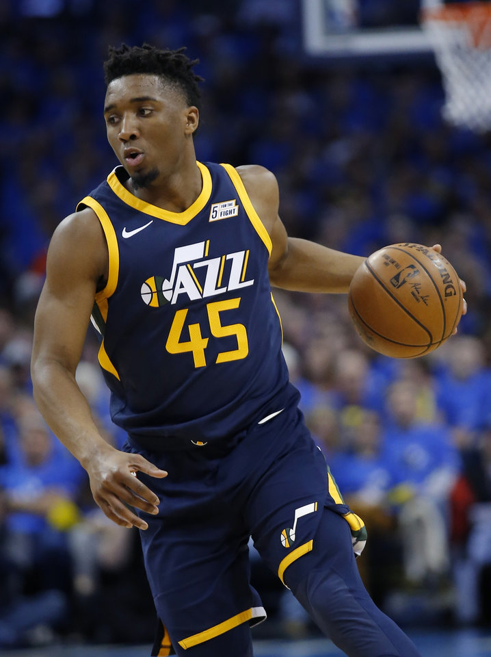 Photo -  Donovan Mitchell (45) drives up court during Game 1 of the Jazz's first-round playoff series against the Thunder on April 15, 2018. [Sarah Phipps, The Oklahoman]