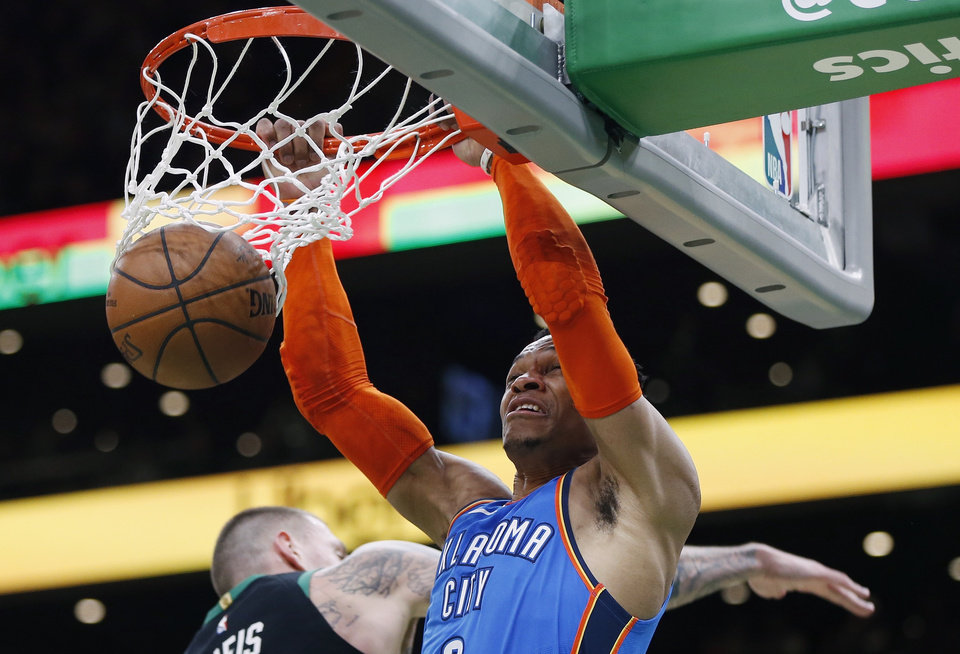 Photo - Oklahoma City Thunder's Russell Westbrook, right, dunks during the second half of an NBA basketball game against the Boston Celtics in Boston, Sunday, Feb. 3, 2019. (AP Photo/Michael Dwyer)