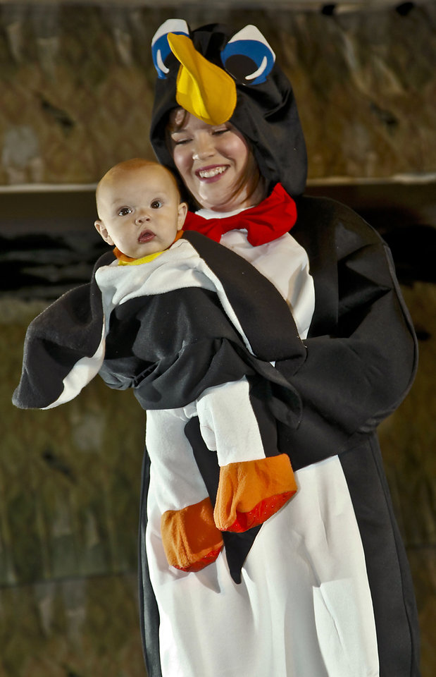 Photo - Jamie and Liam model penguin costumes in adult and baby sizes. Photo by Chris Landsberger, The Oklahoman.  CHRIS LANDSBERGER