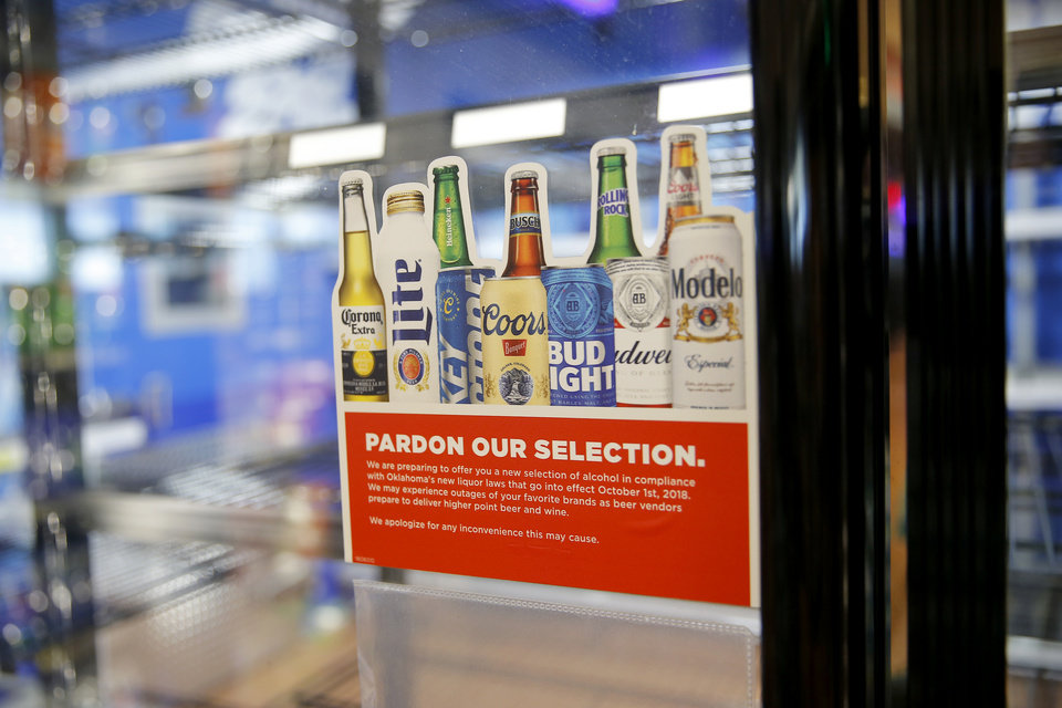 Photo -  Empty shelves inside a beer cooler are seen inside an OnCue in Edmond Tuesday. Only a small selection of 3.2 percent alcohol by volume beer remains in some convenience stores until high-point beer becomes available on October 1. [Photo by Bryan Terry, The Oklahoman]