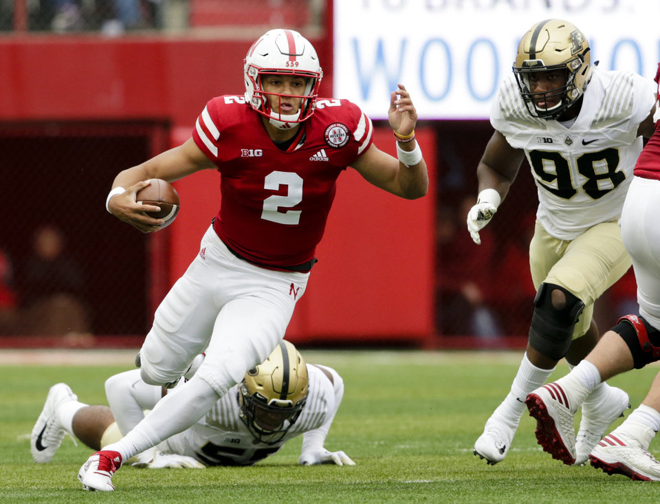Photo - FILE - In this Sept. 29, 2018, file photo, Nebraska quarterback Adrian Martinez (2) carries the ball away from Purdue linebacker Derrick Barnes (55) and defensive end Kai Higgins (98) during the first half of an NCAA college football game in Lincoln, Neb. Ohio State hosts Nebraska on Saturday, Oct. 24, 2020. (AP Photo/Nati Harnik, File)