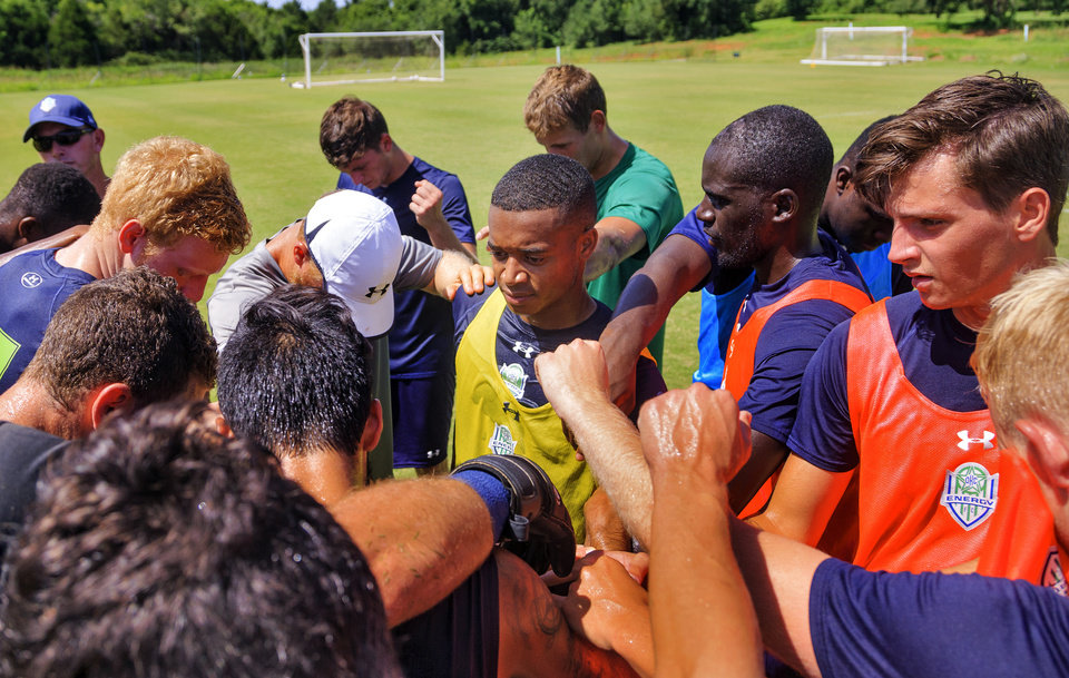 Photo -  Josh Garcia, center, midfielder for the Energy FC's U-23 team huddles up with the team after practice in Oklahoma City, Okla. on Tuesday, July 3, 2018. Photo by Chris Landsberger, The Oklahoman