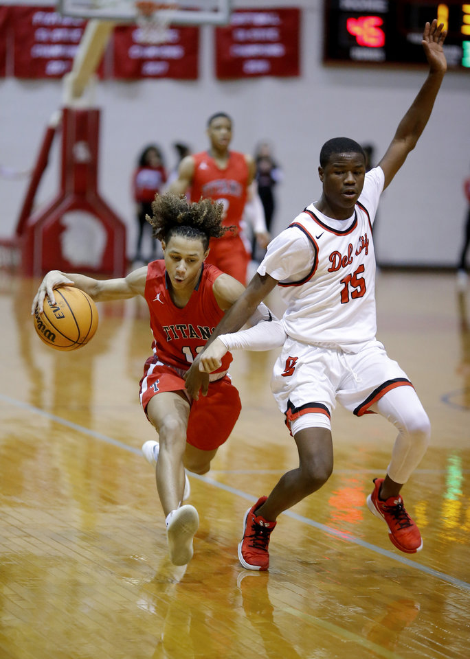 Photo - Carl Albert's Jaden Harrell tries to get by Del City's Hilton Baker during the Carl Albert Titan Invitational tournament championship boys basketball game between Del City and Carl Albert at Carl Albert High School  in Midwest City,Saturday, Jan. 25, 2020.  [Sarah Phipps/The Oklahoman]