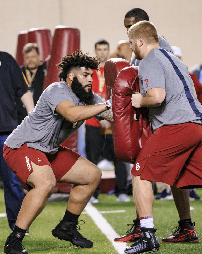 Photo - Cody Ford, left, goes through lineman drills as he works out for NFL scouts during the University of Oklahoma football pro day at the University of Oklahoma in Norman, Okla. on Wednesday, March 13, 2019.   Photo by Chris Landsberger, The Oklahoman
